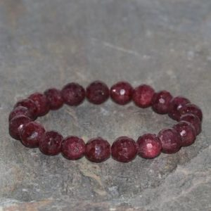 Shop Ruby Bracelets! Faceted Ruby Beaded Bracelet, 8mm Faceted Ruby, Grade AAA, Natural Gemstone Bracelet Gift Stack Unisex Bracelet Red/Purple Ruby | Natural genuine Ruby bracelets. Buy crystal jewelry, handmade handcrafted artisan jewelry for women.  Unique handmade gift ideas. #jewelry #beadedbracelets #beadedjewelry #gift #shopping #handmadejewelry #fashion #style #product #bracelets #affiliate #ad