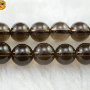 Shop Smoky Quartz Round Beads! Crystal Quartz,15 inch full strand Smoky Quartz smooth round beads 4mm 6mm 8mm 10mm 12mm 14mm for Choice | Natural genuine round Smoky Quartz beads for beading and jewelry making.  #jewelry #beads #beadedjewelry #diyjewelry #jewelrymaking #beadstore #beading #affiliate #ad