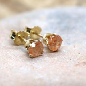 Shop Sunstone Earrings! Sunstone Stud Earrings, Gold Sparkly Sunstone Ear Studs, Peachy Stud Earrings, Dainty Everyday Studs, Gift for Her, Good Luck Stone Earrings | Natural genuine Sunstone earrings. Buy crystal jewelry, handmade handcrafted artisan jewelry for women.  Unique handmade gift ideas. #jewelry #beadedearrings #beadedjewelry #gift #shopping #handmadejewelry #fashion #style #product #earrings #affiliate #ad
