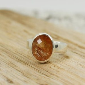 Shop Sunstone Rings! Beautiful Sunstone ring oval shape faceted cut sunstone red and orange rutile set on 925 sterling silver nice solid mount nickel free silver | Natural genuine Sunstone rings, simple unique handcrafted gemstone rings. #rings #jewelry #shopping #gift #handmade #fashion #style #affiliate #ad