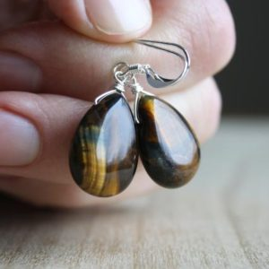 Shop Tiger Eye Jewelry! Tigers Eye Earrings Women's . Natural Stone Earrings Silver . Yellow Tiger Eye Earrings | Natural genuine Tiger Eye jewelry. Buy crystal jewelry, handmade handcrafted artisan jewelry for women.  Unique handmade gift ideas. #jewelry #beadedjewelry #beadedjewelry #gift #shopping #handmadejewelry #fashion #style #product #jewelry #affiliate #ad
