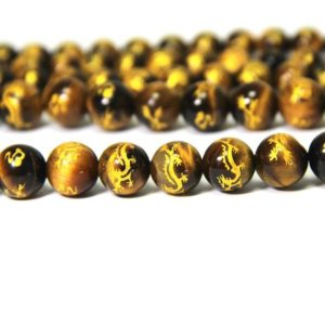 Yellow Tiger Eye Beads Carved Dragon Beads 8mm 10mm Natural Tiger Eye Painted Chinese Dragon Beads Gold Spacer Beads Dragon Jewelry Supplies | Natural genuine other-shape Gemstone beads for beading and jewelry making.  #jewelry #beads #beadedjewelry #diyjewelry #jewelrymaking #beadstore #beading #affiliate #ad