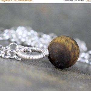 Shop Tiger Eye Pendants! Matte Tiger Eye Pendant – Rustic Tiger Eye Necklace – Sterling Silver Layering Necklace – Brown Gemstone Pendant for Men and Women | Natural genuine Tiger Eye pendants. Buy handcrafted artisan men's jewelry, gifts for men.  Unique handmade mens fashion accessories. #jewelry #beadedpendants #beadedjewelry #shopping #gift #handmadejewelry #pendants #affiliate #ad