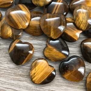 Shop Tiger Eye Shapes! Tigers Eye Heart Crystal 25 mm | Pocket Stone | Palm Stone | Worry Stone | Small | Natural genuine stones & crystals in various shapes & sizes. Buy raw cut, tumbled, or polished gemstones for making jewelry or crystal healing energy vibration raising reiki stones. #crystals #gemstones #crystalhealing #crystalsandgemstones #energyhealing #affiliate #ad