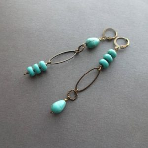 Shop Turquoise Earrings! Long Mismatched earrings. blue Turquoise Dangle earrings. Asymmetrical Earrings Bronze, Turquoise. different earrings. Gift idea. for women. | Natural genuine Turquoise earrings. Buy crystal jewelry, handmade handcrafted artisan jewelry for women.  Unique handmade gift ideas. #jewelry #beadedearrings #beadedjewelry #gift #shopping #handmadejewelry #fashion #style #product #earrings #affiliate #ad