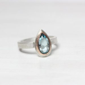 Shop Zircon Rings! Modern Muted Blue Zircon Silver Rose Gold Ring Pear Cabochon Pale Steel 14K Pink Bezel Subtle Pastel Colors Gift Idea For Her – Sky Tear | Natural genuine Zircon rings, simple unique handcrafted gemstone rings. #rings #jewelry #shopping #gift #handmade #fashion #style #affiliate #ad