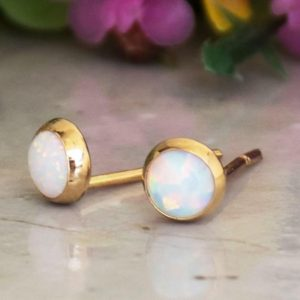 Shop Raw Opal Earrings! 14K Gold Tiny White Opal Studs, Opal Jewelry, Fire Opal Earrings, Small Earrings, Dainty Gold Earrings, Handmade Earrings, Everyday Earrings | Natural genuine Opal earrings. Buy crystal jewelry, handmade handcrafted artisan jewelry for women.  Unique handmade gift ideas. #jewelry #beadedearrings #beadedjewelry #gift #shopping #handmadejewelry #fashion #style #product #earrings #affiliate #ad