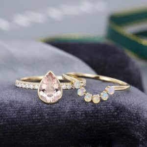 2PCS Pear shaped Morganite engagement ring set Moissanite Solid 14K yellow gold ring vintage Curved Opal ring bridal set anniversary gift | Natural genuine Array rings, simple unique alternative gemstone engagement rings. #rings #jewelry #bridal #wedding #jewelryaccessories #engagementrings #weddingideas #affiliate #ad