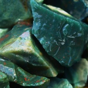 Shop Raw & Rough Bloodstone Stones! 3000 Carat Lots of Bloodstone Rough Plus a Very Nice FREE Faceted Gemstone | Natural genuine stones & crystals in various shapes & sizes. Buy raw cut, tumbled, or polished gemstones for making jewelry or crystal healing energy vibration raising reiki stones. #crystals #gemstones #crystalhealing #crystalsandgemstones #energyhealing #affiliate #ad