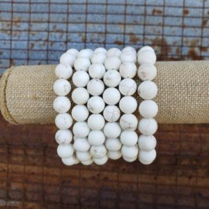 Shop Magnesite Bracelets! 8mm / 10mm Stretch Matte White Howlite Bracelet, Large Stretch White Matte Bracelet, Large White Bracelet | Natural genuine Magnesite bracelets. Buy crystal jewelry, handmade handcrafted artisan jewelry for women.  Unique handmade gift ideas. #jewelry #beadedbracelets #beadedjewelry #gift #shopping #handmadejewelry #fashion #style #product #bracelets #affiliate #ad