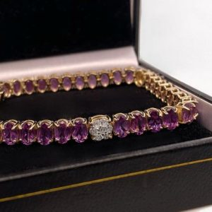 Shop Alexandrite Bracelets! Alexandrite and Diamond June Birthstone Oval Tennis Bracelet in Solid 14k Yellow Gold | Natural genuine Alexandrite bracelets. Buy crystal jewelry, handmade handcrafted artisan jewelry for women.  Unique handmade gift ideas. #jewelry #beadedbracelets #beadedjewelry #gift #shopping #handmadejewelry #fashion #style #product #bracelets #affiliate #ad