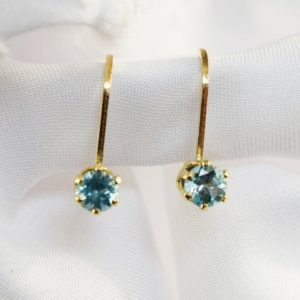 Shop Apatite Earrings! Blue Apatite Earrings, Genuine Gemstones 4mm Rounds, Set in 14 kt Yellow Gold Filled Lever Back Earrings | Natural genuine Apatite earrings. Buy crystal jewelry, handmade handcrafted artisan jewelry for women.  Unique handmade gift ideas. #jewelry #beadedearrings #beadedjewelry #gift #shopping #handmadejewelry #fashion #style #product #earrings #affiliate #ad