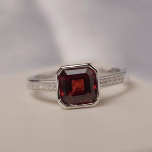 Asscher cut garnet ring bezel setting engagement ring for women January birthstone | Natural genuine Gemstone rings, simple unique alternative gemstone engagement rings. #rings #jewelry #bridal #wedding #jewelryaccessories #engagementrings #weddingideas #affiliate #ad