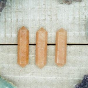 Shop Aventurine Points & Wands! Orange Aventurine Double Terminated Crystals (3) | Natural genuine stones & crystals in various shapes & sizes. Buy raw cut, tumbled, or polished gemstones for making jewelry or crystal healing energy vibration raising reiki stones. #crystals #gemstones #crystalhealing #crystalsandgemstones #energyhealing #affiliate #ad