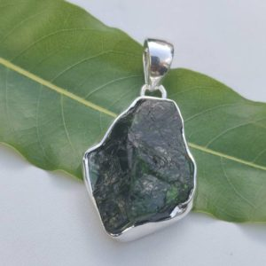 Shop Diopside Pendants! Beautiful rough chrome diopside sterling silver pendant,925 purity,natural raw stone,32*22*8mm size,chrome unblocks your heart chakra | Natural genuine Diopside pendants. Buy crystal jewelry, handmade handcrafted artisan jewelry for women.  Unique handmade gift ideas. #jewelry #beadedpendants #beadedjewelry #gift #shopping #handmadejewelry #fashion #style #product #pendants #affiliate #ad