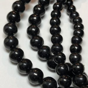 """Black JET (Lignite – a precursor to coal) gemstone beads. 15"""" strand of round beads available in 4-12mm. Light weight; organic.   Natural genuine round Jet beads for beading and jewelry making.  #jewelry #beads #beadedjewelry #diyjewelry #jewelrymaking #beadstore #beading #affiliate #ad"""