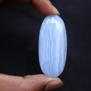 Shop Blue Lace Agate Shapes! A+ Blue Lace Agate Palm Stone, Natural Untreated Banded Agate Pocket Stone, Healing Crystal, Polished Palm stone Light Blue Crystal | Natural genuine stones & crystals in various shapes & sizes. Buy raw cut, tumbled, or polished gemstones for making jewelry or crystal healing energy vibration raising reiki stones. #crystals #gemstones #crystalhealing #crystalsandgemstones #energyhealing #affiliate #ad