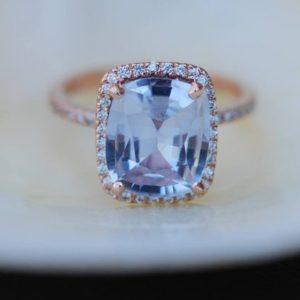 Shop Sapphire Rings! Blue sapphire engagement ring. 14k rose gold ring with certified 5.6ct cushion blue gray sapphire. Engagement ring by Eidelprecious | Natural genuine Sapphire rings, simple unique alternative gemstone engagement rings. #rings #jewelry #bridal #wedding #jewelryaccessories #engagementrings #weddingideas #affiliate #ad
