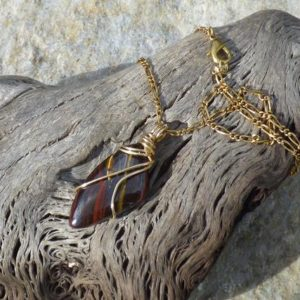 "Shop Tiger Iron Pendants! Brown, gold and red iron tiger eye free form wire wrapped pendant in brass wire with an 18"" antique gold figaro chain necklace 