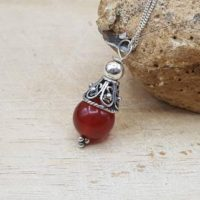 Minimalist Red Carnelian Cone Pendant. July Birthstone Necklace. 17th Anniversary Gemstone. Reiki Jewelry Uk. 10mm Stone | Natural genuine Gemstone jewelry. Buy crystal jewelry, handmade handcrafted artisan jewelry for women.  Unique handmade gift ideas. #jewelry #beadedjewelry #beadedjewelry #gift #shopping #handmadejewelry #fashion #style #product #jewelry #affiliate #ad