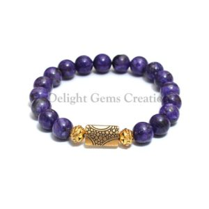 Shop Charoite Bracelets! Charoite Natural Smooth Round Beaded Stretch Bracelet, 10 mm Charoite Beads, Third Eye Chakra Bracelet, Meditation Bracelet, Yoga Bracelet | Natural genuine Charoite bracelets. Buy crystal jewelry, handmade handcrafted artisan jewelry for women.  Unique handmade gift ideas. #jewelry #beadedbracelets #beadedjewelry #gift #shopping #handmadejewelry #fashion #style #product #bracelets #affiliate #ad