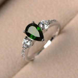Shop Diopside Rings! Natural chrome diopside ring, wedding ring, pear cut ring, green gemstone ring, sterling silver ring | Natural genuine Diopside rings, simple unique alternative gemstone engagement rings. #rings #jewelry #bridal #wedding #jewelryaccessories #engagementrings #weddingideas #affiliate #ad