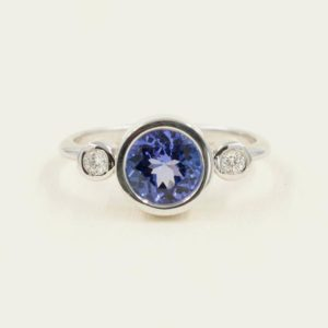 Shop Tanzanite Rings! Genuine Round Tanzanite Engagement ring.Bezel set 7mm Tanzanite Promise Ring.14K White Gold Diamond Bridal Ring.Unique Engagement Ring | Natural genuine Tanzanite rings, simple unique alternative gemstone engagement rings. #rings #jewelry #bridal #wedding #jewelryaccessories #engagementrings #weddingideas #affiliate #ad
