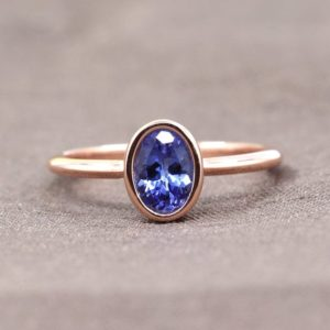 Genuine Tanzanite Engagement Ring/Oval Shaped Tanzanite Engagement Wedding Ring/Solitaire Engagement ring/14K Solid gold Wedding Ring | Natural genuine Array rings, simple unique alternative gemstone engagement rings. #rings #jewelry #bridal #wedding #jewelryaccessories #engagementrings #weddingideas #affiliate #ad