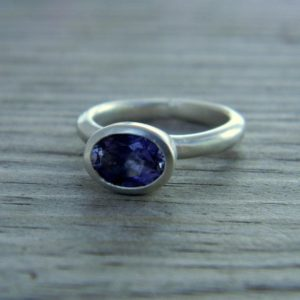 Shop Iolite Rings! Periwinkle Blue Iolite Horizontal Oval Ring in Matte Argentium Silver | Natural genuine Iolite rings, simple unique handcrafted gemstone rings. #rings #jewelry #shopping #gift #handmade #fashion #style #affiliate #ad