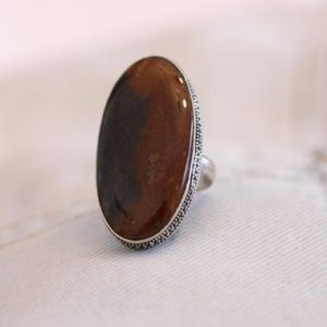 Shop Mahogany Obsidian Rings! Large Obsidian Oval Gemstone Ring Stamped 925 Brown Mahogany & Black Tones Deep Artisan Setting Statement Vintage Boho Size 7 1/4 to 7 1/2 | Natural genuine Mahogany Obsidian rings, simple unique handcrafted gemstone rings. #rings #jewelry #shopping #gift #handmade #fashion #style #affiliate #ad