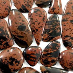 Shop Mahogany Obsidian Cabochons! Mahogany Obsidian Cabochon Lots // Obsidian Cabochon // Gems // Cabochons // Jewelry Making Supplies / Village Silversmith | Natural genuine stones & crystals in various shapes & sizes. Buy raw cut, tumbled, or polished gemstones for making jewelry or crystal healing energy vibration raising reiki stones. #crystals #gemstones #crystalhealing #crystalsandgemstones #energyhealing #affiliate #ad
