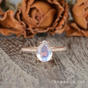 Shop Moonstone Rings! Moonstone Engagement Ring Pear Shaped Rose Gold Engagement Ring Ring For Women Solitaire Ring Rose Gold Blue Moonstone Gift Custom For Her | Natural genuine Moonstone rings, simple unique alternative gemstone engagement rings. #rings #jewelry #bridal #wedding #jewelryaccessories #engagementrings #weddingideas #affiliate #ad