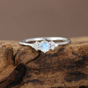 Moonstone engagement ring White gold Diamond cluster engagement ring Unique Simple Thin dainty wedding ring Bridal  Promise Anniversary gift | Natural genuine Gemstone rings, simple unique alternative gemstone engagement rings. #rings #jewelry #bridal #wedding #jewelryaccessories #engagementrings #weddingideas #affiliate #ad