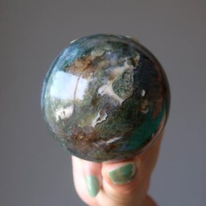 Shop Moss Agate Shapes! Green Moss Agate Sphere Abundant Crystal Ball | Natural genuine stones & crystals in various shapes & sizes. Buy raw cut, tumbled, or polished gemstones for making jewelry or crystal healing energy vibration raising reiki stones. #crystals #gemstones #crystalhealing #crystalsandgemstones #energyhealing #affiliate #ad