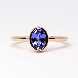 Natural Tanzanite Engagement Ring, Dainty Tanzanite Ring,Oval Tanzanite Solitaire Ring.Tanzanite Wedding Ring.7×5 Real AAA Natural Tanzanite | Natural genuine Array rings, simple unique alternative gemstone engagement rings. #rings #jewelry #bridal #wedding #jewelryaccessories #engagementrings #weddingideas #affiliate #ad