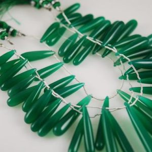 Shop Onyx Beads! 1/2 strand Huge Scrumptious Green Onyx smooth drops SALE 10.00 | Natural genuine beads Onyx beads for beading and jewelry making.  #jewelry #beads #beadedjewelry #diyjewelry #jewelrymaking #beadstore #beading #affiliate #ad