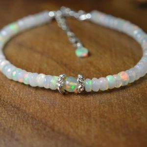 Shop Opal Bracelets! Dainty Welo Opal Bracelet in Sterling Silver // October Birthstone // 14th Anniversary // Genuine Welo Opal // Gemstone Stacking Bracelet | Natural genuine Opal bracelets. Buy crystal jewelry, handmade handcrafted artisan jewelry for women.  Unique handmade gift ideas. #jewelry #beadedbracelets #beadedjewelry #gift #shopping #handmadejewelry #fashion #style #product #bracelets #affiliate #ad