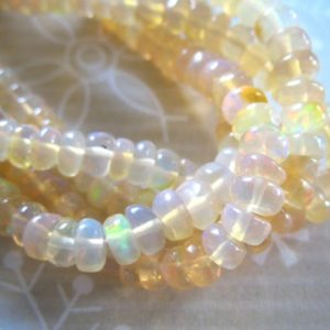 Shop Opal Rondelle Beads! Opal Rondelle Beads / 3.5-4.5 mm / 20-100 pcs /  Luxe AAA / Smooth /Ethiopian Opal / shaded creme / golden w rainbow flash exotic | Natural genuine rondelle Opal beads for beading and jewelry making.  #jewelry #beads #beadedjewelry #diyjewelry #jewelrymaking #beadstore #beading #affiliate #ad