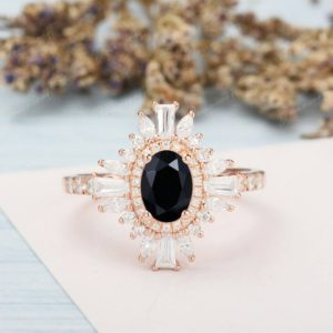 Oval Black Onyx Engagement Ring Rose Gold Vintage Halo Engagement Ring 14K Diamond / CZ Unique Bridal Wedding Ring Anniversary Gifts | Natural genuine Array rings, simple unique alternative gemstone engagement rings. #rings #jewelry #bridal #wedding #jewelryaccessories #engagementrings #weddingideas #affiliate #ad