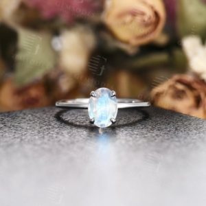 Shop Moonstone Engagement Rings! Oval Cut Moonstone engagement ring, vintage white gold unique engagement ring, Solitare dainty wedding ring, Prong set Anniversary gift | Natural genuine Moonstone rings, simple unique alternative gemstone engagement rings. #rings #jewelry #bridal #wedding #jewelryaccessories #engagementrings #weddingideas #affiliate #ad