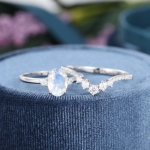 Shop Moonstone Engagement Rings! Oval cut Moonstone engagement ring set white gold Unique engagement ring vintage Curved moissanite wedding Bridal Anniversary gift for women | Natural genuine Moonstone rings, simple unique alternative gemstone engagement rings. #rings #jewelry #bridal #wedding #jewelryaccessories #engagementrings #weddingideas #affiliate #ad