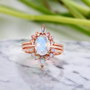 Oval cut Moonstone engagement ring solitaire rose gold, Marquise & round cut moonstone curved Wedding band, opal wedding band unique set | Natural genuine Gemstone rings, simple unique alternative gemstone engagement rings. #rings #jewelry #bridal #wedding #jewelryaccessories #engagementrings #weddingideas #affiliate #ad