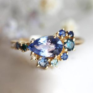 Shop Sapphire Rings! Pear Blue Sapphire Engagement Ring, Pear Sapphire Cluster Engagement Ring, Blue Sapphire Ring, Unique Multistone Engagement Ring | Natural genuine Sapphire rings, simple unique alternative gemstone engagement rings. #rings #jewelry #bridal #wedding #jewelryaccessories #engagementrings #weddingideas #affiliate #ad