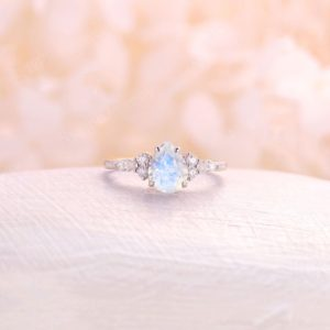 Pear cut moonstone engagement ring White Gold moonstone ring unique Moissanite halo Unique   Bridal rings Promise Anniversary | Natural genuine Array jewelry. Buy handcrafted artisan wedding jewelry.  Unique handmade bridal jewelry gift ideas. #jewelry #beadedjewelry #gift #crystaljewelry #shopping #handmadejewelry #wedding #bridal #jewelry #affiliate #ad