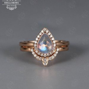 Shop Healing Gemstone Rings! Pear Shaped Moonstone engagement ring Vintage Halo moissanite/diamond Curved Wedding Antique  Stacking Bridal set Promise Anniversary | Natural genuine Gemstone rings, simple unique alternative gemstone engagement rings. #rings #jewelry #bridal #wedding #jewelryaccessories #engagementrings #weddingideas #affiliate #ad
