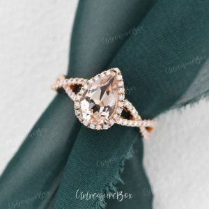 Pear Shaped Morganite Engagement Ring Rose Gold Unique Infinity Morganite Bridal Ring Split Shank Peachy Morganite Ring Pear Halo Promise | Natural genuine Array rings, simple unique alternative gemstone engagement rings. #rings #jewelry #bridal #wedding #jewelryaccessories #engagementrings #weddingideas #affiliate #ad