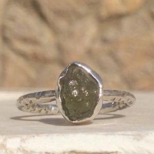 Shop Peridot Rings! Womens' Peridot Ring, Raw Stone Silver Ring, Natural August Birthstone Silver Ring | Natural genuine Peridot rings, simple unique handcrafted gemstone rings. #rings #jewelry #shopping #gift #handmade #fashion #style #affiliate #ad
