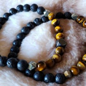 Shop Tiger Iron Bracelets! Protective Tiger Iron stretchy Bracelet; Hematite, Lava Rock, Pyrite   Natural genuine Tiger Iron bracelets. Buy crystal jewelry, handmade handcrafted artisan jewelry for women.  Unique handmade gift ideas. #jewelry #beadedbracelets #beadedjewelry #gift #shopping #handmadejewelry #fashion #style #product #bracelets #affiliate #ad