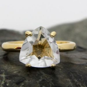 Shop Quartz Crystal Jewelry! gold trillion ring,crystal quartz ring,thin gold filled ring,thin stack ring,stacking ring,stackable ring | Natural genuine Quartz jewelry. Buy crystal jewelry, handmade handcrafted artisan jewelry for women.  Unique handmade gift ideas. #jewelry #beadedjewelry #beadedjewelry #gift #shopping #handmadejewelry #fashion #style #product #jewelry #affiliate #ad