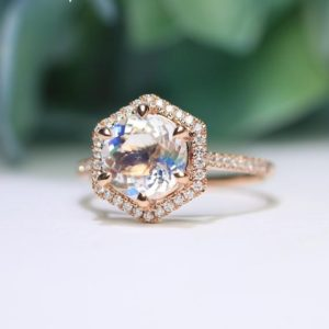 Shop Rainbow Moonstone Rings! Rainbow Moonstone Engagement Ring Vintage 14K Rose Gold Round Cut Moonstone Art Deco Hexagon Halo Diamond Wedding Ring Unique Promise Ring | Natural genuine Rainbow Moonstone rings, simple unique alternative gemstone engagement rings. #rings #jewelry #bridal #wedding #jewelryaccessories #engagementrings #weddingideas #affiliate #ad